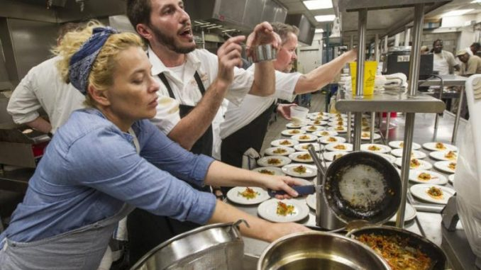 Local chefs and cooks line up dozens of plates as they prepare dinner at the Audubon Nature Institute's Gulf United for Lasting Fisheries (G.U.L.F.) dinner at the Aquarium of Americas in New Orleans on Thursday, September 24, 2015. (Photo by Chris Granger, Nola.com | The Times-Picayune)